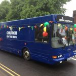 The Bus decorated with bunting and balloons for the Whit Walk
